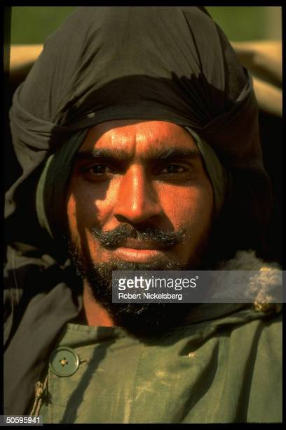 Sikh Indian army soldier w. Black cloth-over-turban & beard serving w. Mostly BSF paramil. Forces enforcing curfew imposed on separatist-minded...