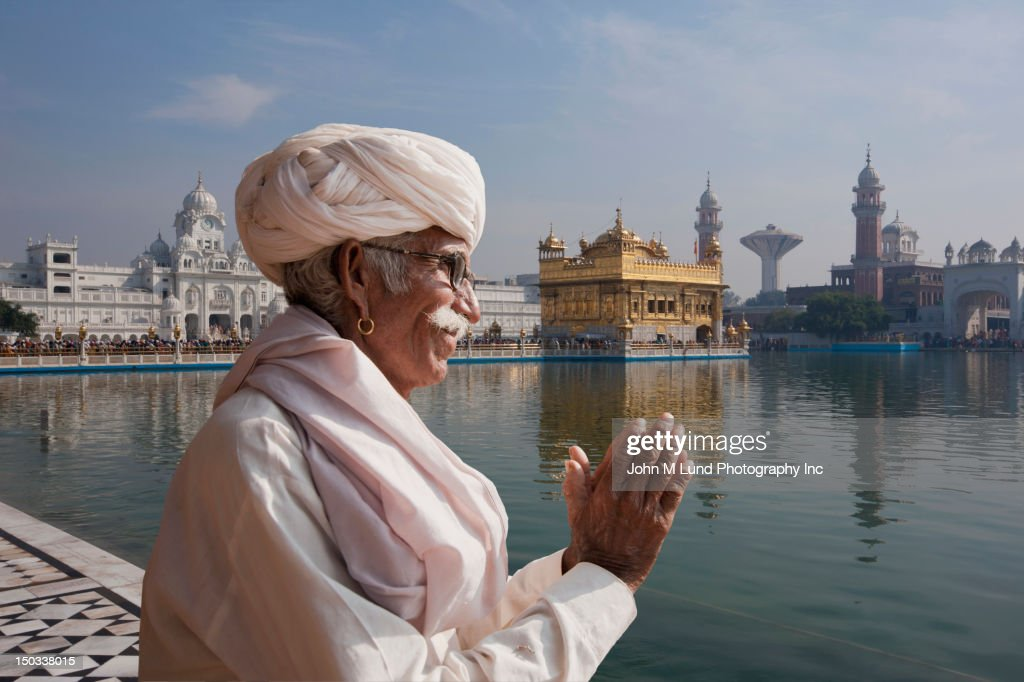 Sikh Indian man prays at the Golden Temple in Amritsar, India
