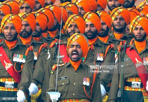 Sikh Light Infantry regiment jawans of Indian Army marching during the 65th Republic Day parade at Rajpath on January 26 2014 in New Delhi India...