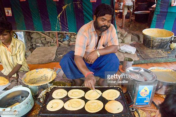 CONTENT] Sikh man cooking pancakes for Hindu pilgrims on their way to the Amarnath Cave Langar manned by Sikh people offer free vegetarian food and...