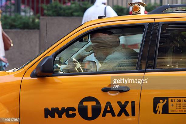A Sikh man drives a taxi in New York on August 6 one day after a shooting at the Sikh Temple of Wisconsin in Oak Creek Wisconsin that left six people...