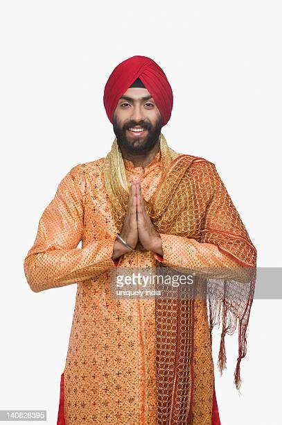 sikh man greeting with smile - prayer pose greeting bildbanksfoton och bilder