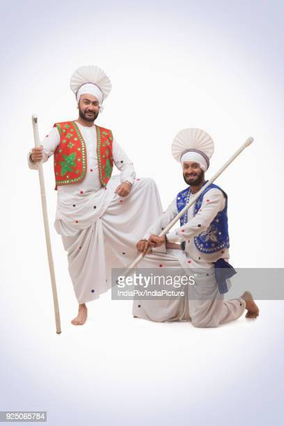 sikh man holding with khundis - lohri festival stock pictures, royalty-free photos & images