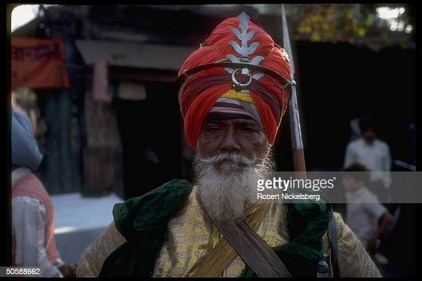 Sikh man sporting magnificent turban during ceremonial procession in honor of 9th Guru's death.