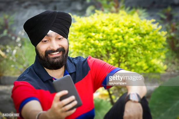 Sikh man taking a selfie.