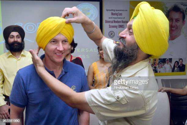 Sikh man tying turban to Former Australian Cricketer and Cochlear's Global Hearing Ambassador Brett Lee during the awareness about the Universal...