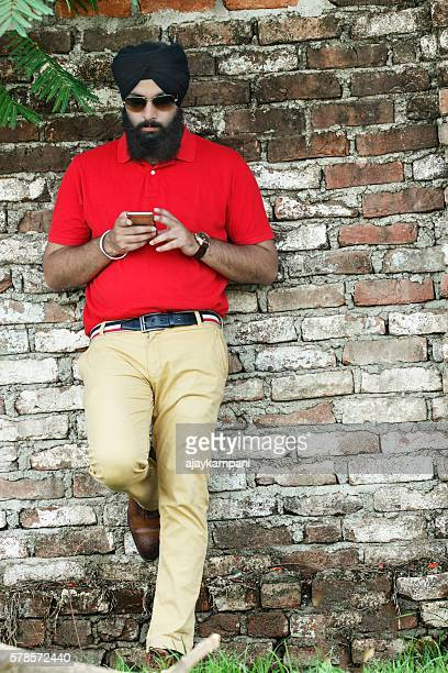Sikh man using smartphone