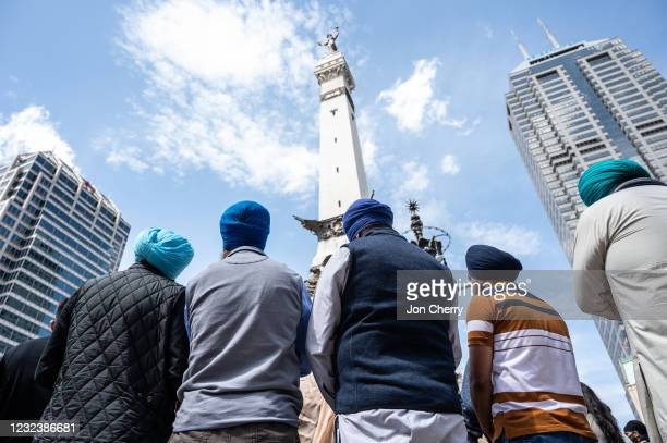 Sikh members of the community listen during a vigil at Monument Circle for the victims of the mass shooting at the FedEx facility on April 18, 2021...