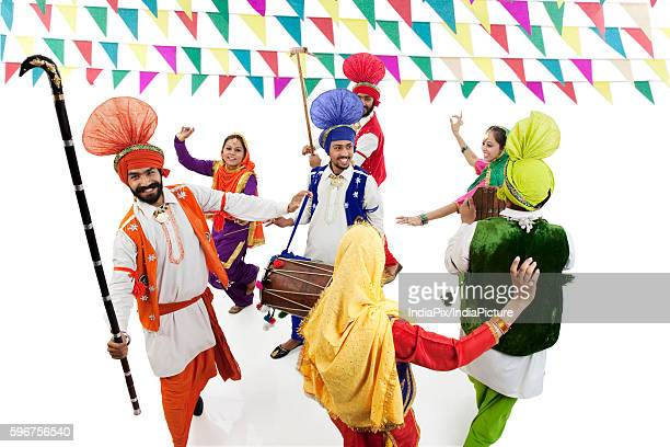 Sikh men and women dancing
