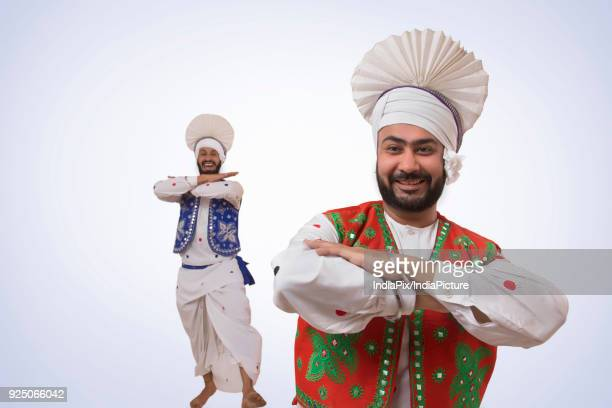 sikh men dancing - lohri festival stock pictures, royalty-free photos & images