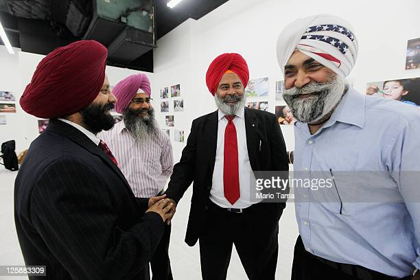 Sikh men gather in front of the opening exhibition of photographer Danny Goldfield's 'NYChildren' project at the grand opening of the Park51...