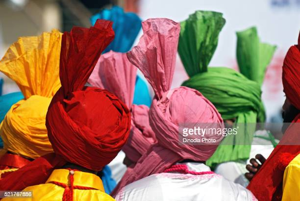 sikh men in celebrations of consecration of sikh guru granth sahib, nanded, maharashtra, india - punjab india stock pictures, royalty-free photos & images