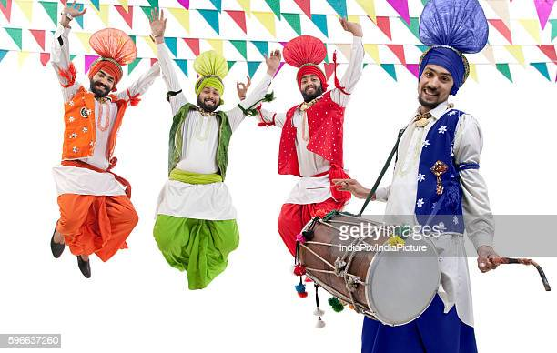 Sikh men jumping in the air