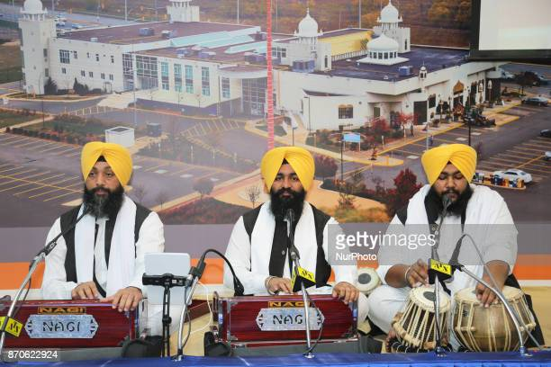 Sikh men sing kirtans at a Gurdwara during Gurpurab on November 04 2017 in Mississauga Ontario Canada Guru Nanak Gurpurab also known as Guru Nanak's...