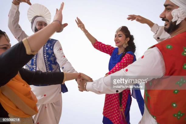sikh people dancing - lohri festival stock pictures, royalty-free photos & images