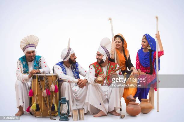 sikh people posing - lohri festival stock pictures, royalty-free photos & images