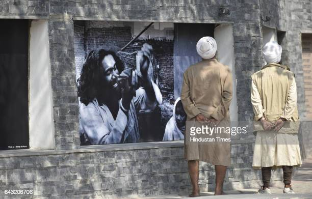 Sikh people watching installation of the Baba Banda Singh Bahadur's statue at Nabha House the Wall of Truth memorial to the victims of the 1984...