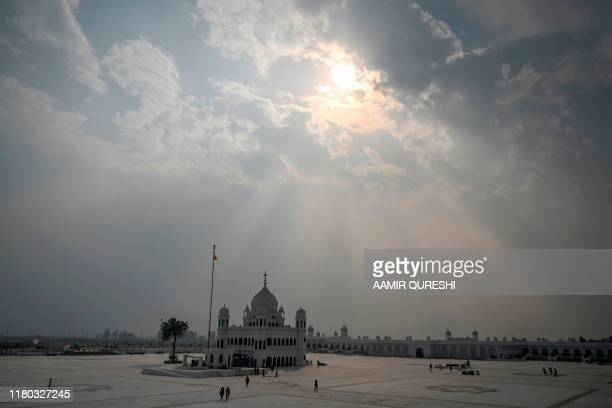 TOPSHOT Sikh pilgrims from different countries visit the Shrine of Baba Guru Nanak Dev at the Gurdwara Darbar Sahib in the Pakistani town of...