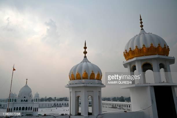 Sikh pilgrims from different countries visit the Shrine of Baba Guru Nanak Dev at the Gurdwara Darbar Sahib in the Pakistani town of Kartarpur near...
