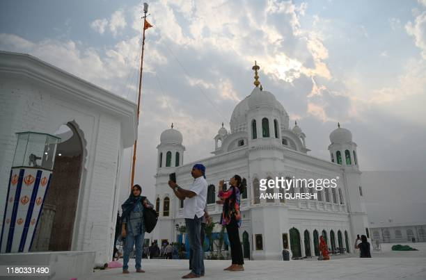 Sikh pilgrims from different countries visit the Shrine of Baba Guru Nanak Dev at the Gurdwara Darbar Sahib in the Pakistani town of Kartarpur near...