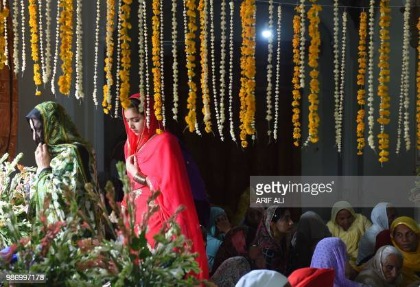 Sikh pilgrims gather at the mausoleum of Maharaja Ranjit Singh during commemorations for his 179th death anniversary in the eastern city of Lahore on...