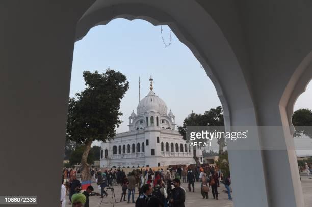 Sikh Pilgrims gather in front of Kartarpur Gurdwara Sahib before a groundbreaking ceremony for the Kartarpur Corridor in Kartarpur on November 28...