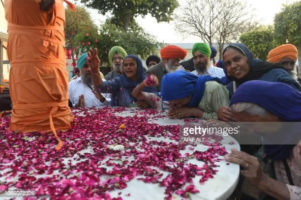 Sikh Pilgrims gather in the Kartarpur Gurdwara Sahib after a groundbreaking ceremony for the Kartarpur Corridor in Kartarpur on November 28 2018...