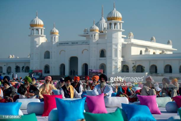 Sikh pilgrims gather to wait the site inauguration in front of the Shrine of Baba Guru Nanak Dev at Gurdwara Darbar Sahib ahead of the ceremony led...