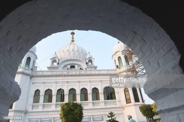 Sikh pilgrims look from Kartarpur Gurdwara Sahib after a groundbreaking ceremony for the Kartarpur Corridor in Kartarpur on November 28 2018 Pakistan...