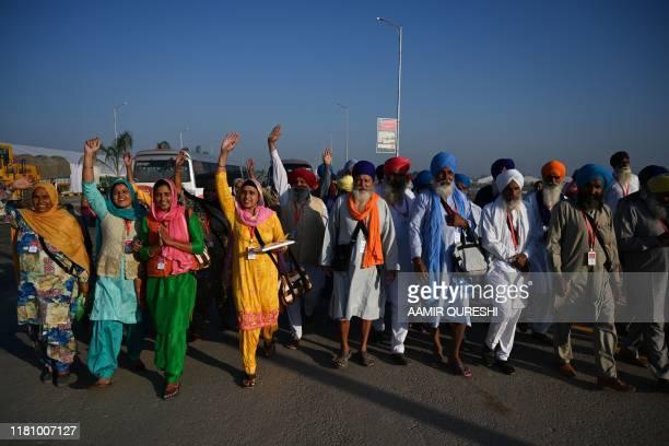 Sikh pilgrims shout slogans as they arrive to visit the Shrine of Baba Guru Nanak Dev at Gurdwara Darbar Sahib in Kartarpur near the Indian border on...
