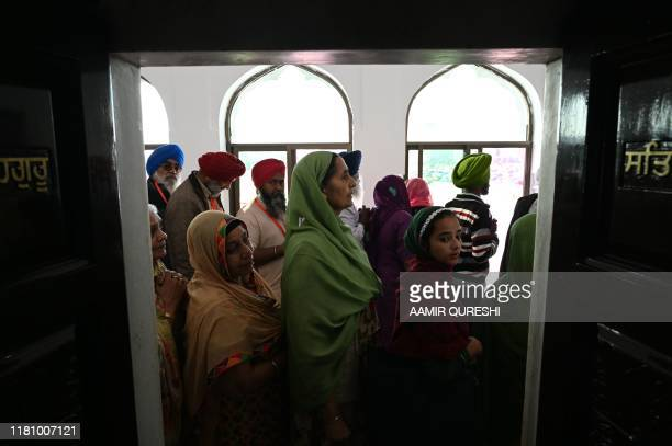Sikh pilgrims visit the Shrine of Baba Guru Nanak Dev at Gurdwara Darbar Sahib in Kartarpur near the Indian border on November 9 2019 Hundreds of...