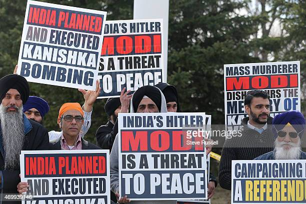 TORONTO ON APRIL 16 Sikh protesters await Indian Prime Minister Narendra Modi before he was to lay a wreath during a visit to the Air India Flight...