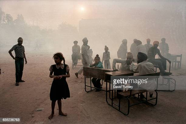 Sikh refugees gather in a New Delhi schoolyard seeking shelter in the turbulent days following the assassination of Prime Minister Indira Gandhi...