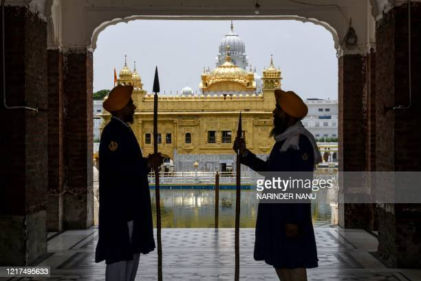 Sikh sewadars stand guard ahead of the 36th Operation Blue Star Anniversary at the Golden Temple in Amritsar on June 4, 2020. - The Indian military's...
