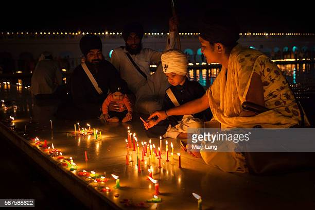 Sikh traditional family celebrating Diwali festival night also Bandi Chhor Divas celebration for the Sikh religion followers at the Gurdwara Dukh...