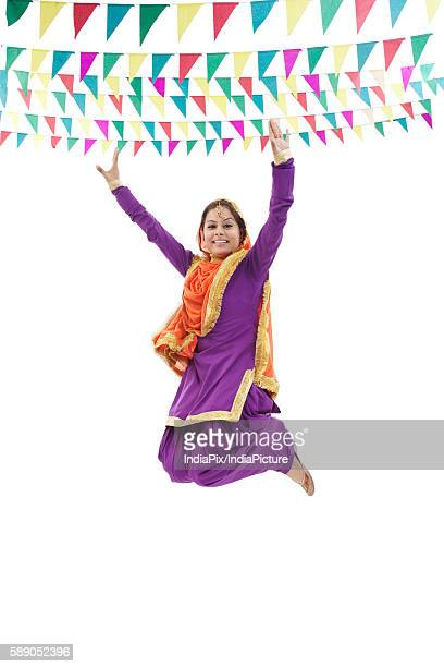 Sikh woman jumping in the air