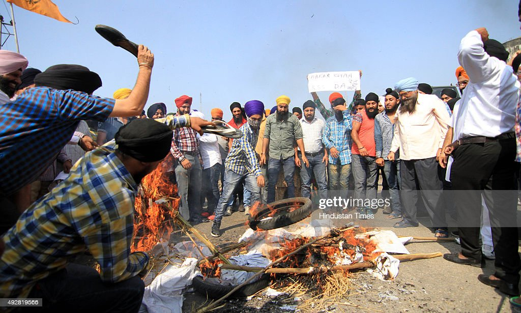 Sikhs burn effigy of Punjab Chief Minister Parkash Singh Badal during a protest against the killing of two Sikh boys on October 15 2015 in Jammu...
