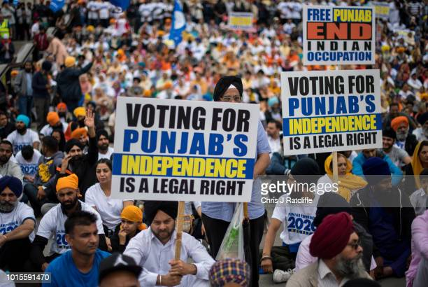 Sikh's chant and hold placards during a rally for independence to the Indian state of Punjab at Trafalgar Square on August 12 2018 in London England...