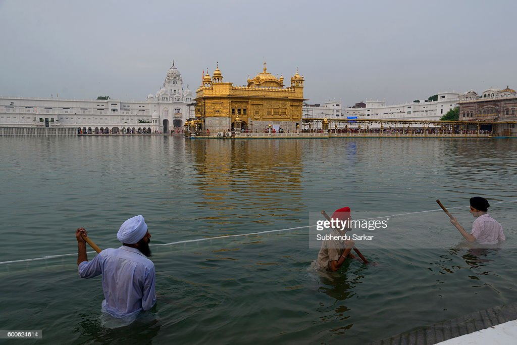 Sikhs clean the holy water of the lake surrounding the Golden Temple Sri Harmandir Sahib or Sri Darbar Sahib or the `Golden Temple` is the holiest...