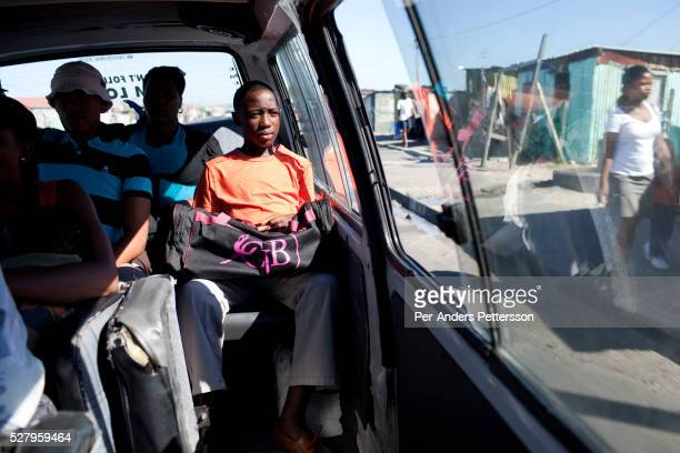 Sikhumbuzo Hlahleni age 15 rides in a taxi to train at Cape Town City Ballet's youth company on March 15 2010 in Cape Town South Africa He trains in...
