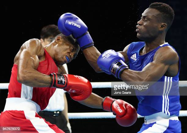 Sikiru Ojo of Nigeria and Samuel Yaw Addo of Ghana competes in the round of 16 bout on day three of the Gold Coast 2018 Commonwealth Games at...