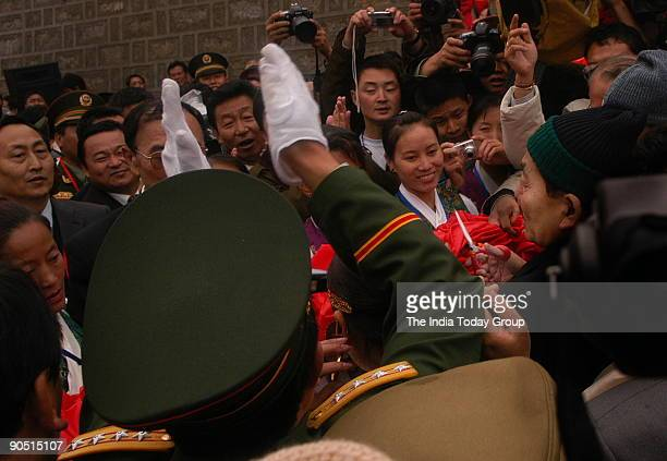 Sikkim chief minister Pawan Chamling cuts the ribbon to formally open Nathu La pass for trading as crowds on the Chinese side applaud and cheer