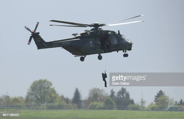 Sikorsky CH53 helicopter of the Bundeswehr conducts a fire and rescue performance at the ILA Berlin Air Show on April 25 2018 in Schoenefeld Germany...