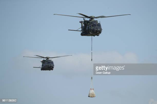 Sikorsky CH53 helicopters of the Bundeswehr conduct a fire and rescue performance at the ILA Berlin Air Show on April 25 2018 in Schoenefeld Germany...
