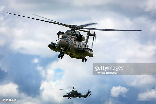 Sikorsky CH53 Sea Stallion heavylift transport helicopter and Eurocopter Tiger attack helicopter of the German Federal Armed Forces during a military...