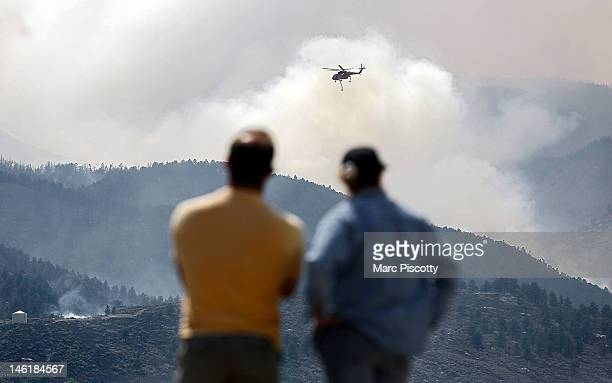 Sikorsky S64 Aircrane firefighting helicopter circles as it prepares to drop water on a hotspot near Horsetooth Reservoir on Monday June 11 2012 near...