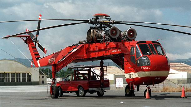 A Sikorsky S–64 Skycrane helicopter, parked at Van Nuys Airport, is ...