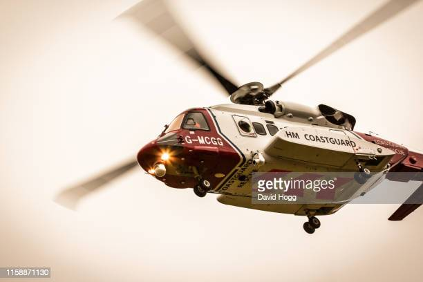 sikorsky s92 rescue helicopter flying overhead - helicopter rotors stock photos and pictures