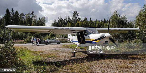 Sila 450 C light aircraft is pictured after it made a forced landing on highway 27, south of the city of Boras in western Sweden, on August 29, 2015....