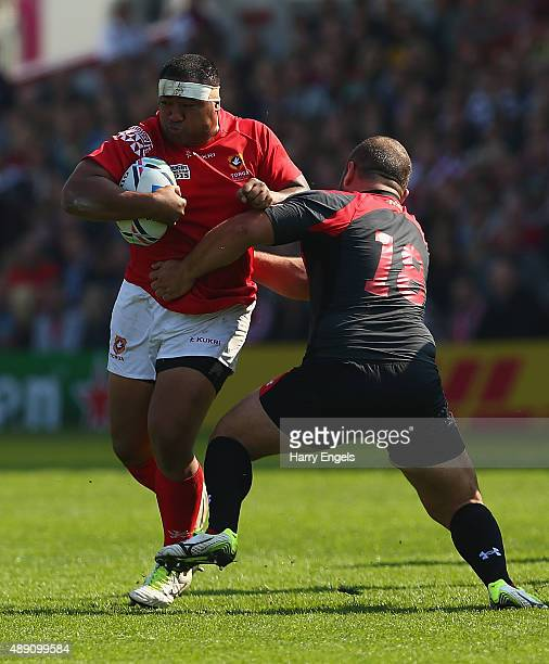 Sila Puafisi of Tonga is tackled by Levan Chilachava of Georgia during the 2015 Rugby World Cup Pool C match between Tonga and Georgia at Kingsholm...